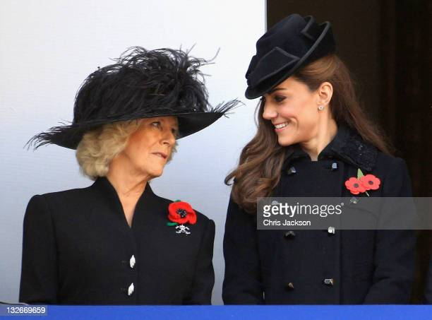 Catherine, Duchess of Cambridge and Camilla, Duchess of Cornwall smile during the Remembrance Day Ceremony at the Cenotaph on November 13, 2011 in...