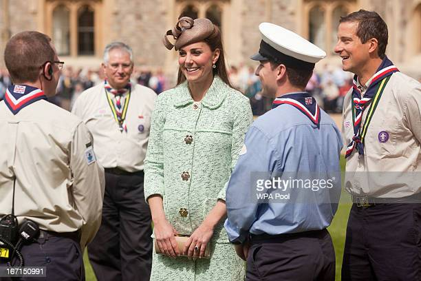 Catherine Duchess of Cambridge and Chief Scout Bear Grylls talk with scouts as she attends the National Review of Queen's Scouts at Windsor Castle on...
