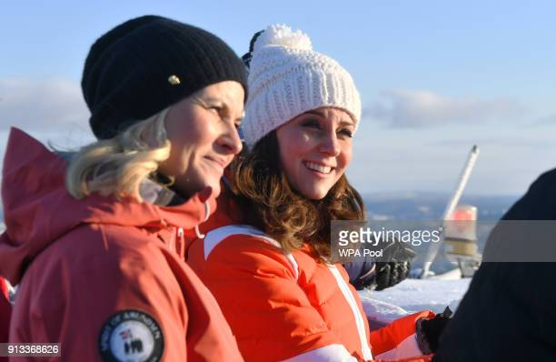 Catherine Duchess of Cambridge and Crown Princess MetteMarit of Norway before meeting junior ski jumpers from Norway's national team at the top of...