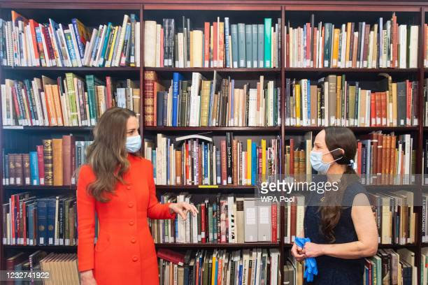 Catherine, Duchess of Cambridge and Curator Magda Keaney during a visit to the archive in the National Portrait Gallery in central London to mark the...