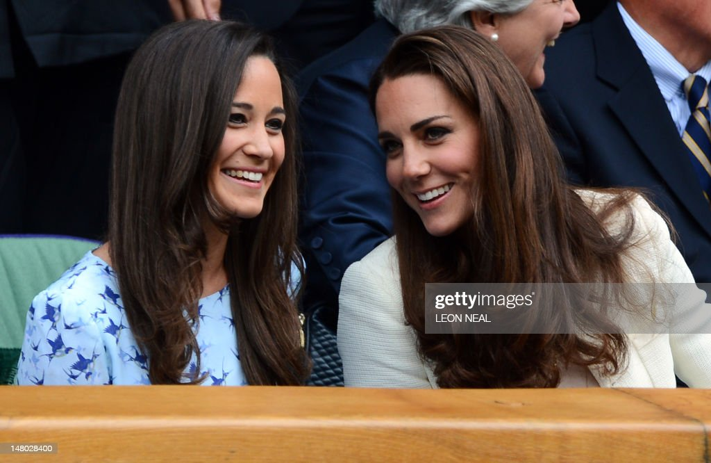 Catherine, Duchess of Cambridge (R) and her sister Pippa Middleton talk in the Royal Box before the men's singles final match between Britain's Andy Murray and Switzerland's Roger Federer on Centre Court on day 13 of the 2012 Wimbledon Championships tennis tournament at the All England Tennis Club in Wimbledon, southwest London, on July 8, 2012.