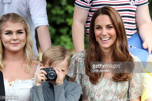 Catherine Duchess of Cambridge and Josh Evans at photography workshop for Action for Children run by the Royal Photographic Society at Warren Park on...