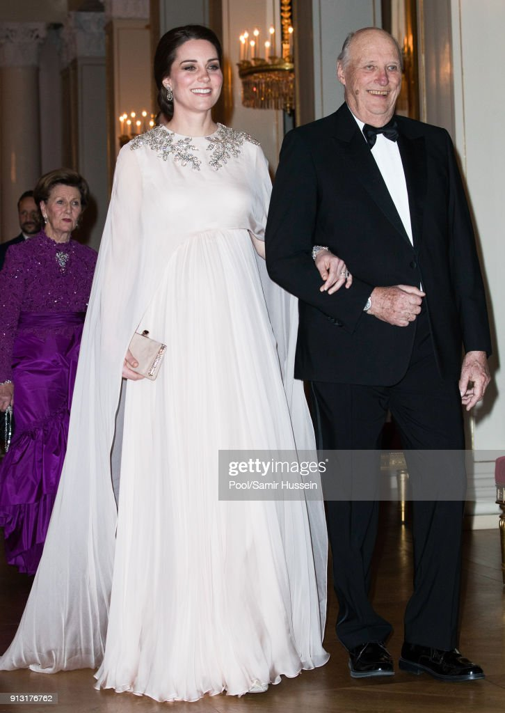 Catherine, Duchess of Cambridge and King Harald V of Norway attend dinner at the Royal Palace on day 3 of their visit to Sweden and Norway on February 1, 2018 in Oslo, Norway.