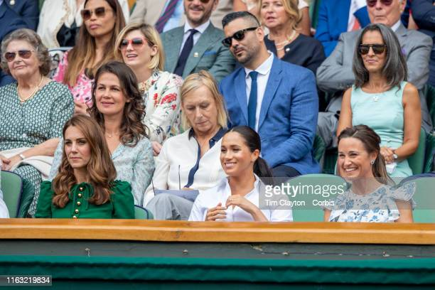 Catherine Duchess of Cambridge and Meghan Duchess of Sussex and Pippa Middleton in the Royal Box on Centre Court during the Serena Williams of the...