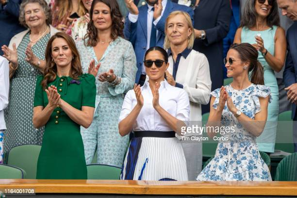 July 13: Catherine, Duchess of Cambridge and Meghan, Duchess of Sussex and Pippa Middleton in the Royal Box on Centre Court applaud the winner Simona...