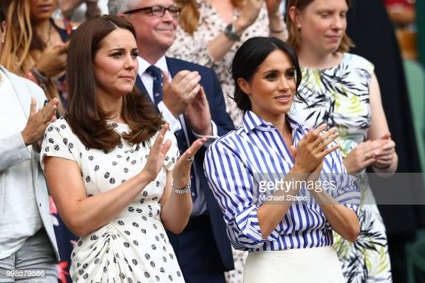 Catherine Duchess of Cambridge and Meghan Duchess of Sussex applaud ahead of the Ladies' Singles final match between Serena Williams of The United...
