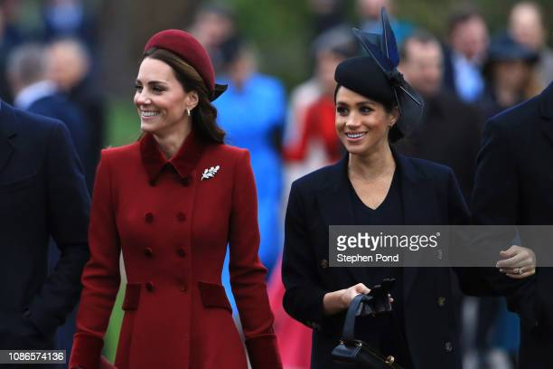 Catherine Duchess of Cambridge and Meghan Duchess of Sussex arrive to attend Christmas Day Church service at Church of St Mary Magdalene on the...