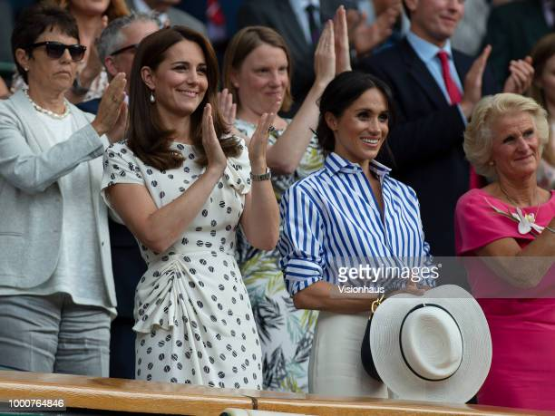 Catherine Duchess of Cambridge and Meghan Duchess of Sussex attend day twelve of the Wimbledon Lawn Tennis Championships at the All England Lawn...