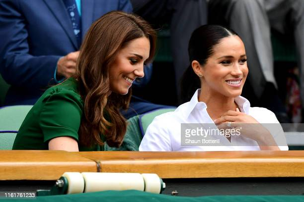 Catherine Duchess of Cambridge and Meghan Duchess of Sussex attend the Royal Box during Day twelve of The Championships Wimbledon 2019 at All England...