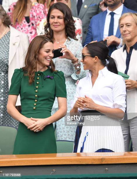 Catherine Duchess of Cambridge and Meghan Duchess of Sussex attend the Women's Singles Final of the Wimbledon Tennis Championships at All England...