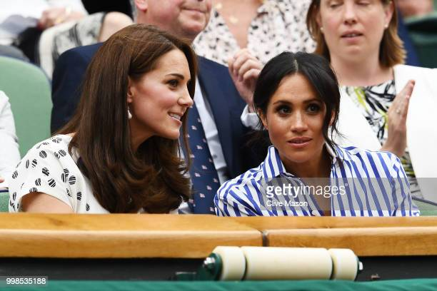 Catherine Duchess of Cambridge and Meghan Duchess of Sussex attend day twelve of the Wimbledon Lawn Tennis Championships at All England Lawn Tennis...