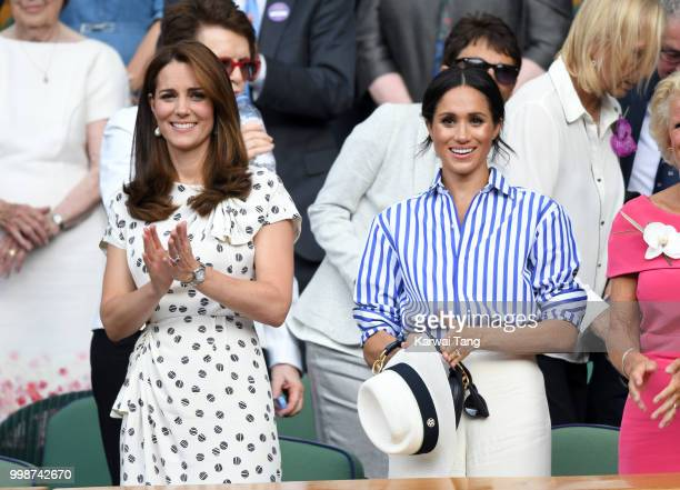 Catherine, Duchess of Cambridge and Meghan, Duchess of Sussex attend day twelve of the Wimbledon Tennis Championships at the All England Lawn Tennis...