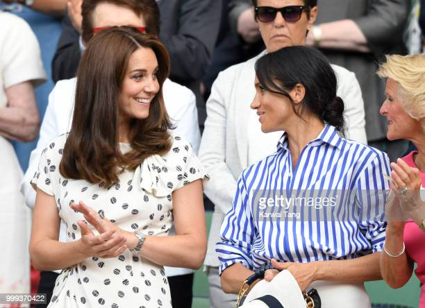 Catherine Duchess of Cambridge and Meghan Duchess of Sussex attend day twelve of the Wimbledon Tennis Championships at the All England Lawn Tennis...