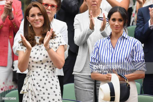 Catherine Duchess of Cambridge and Meghan Duchess of Sussex attends day twelve of the Wimbledon Tennis Championships at the All England Lawn Tennis...