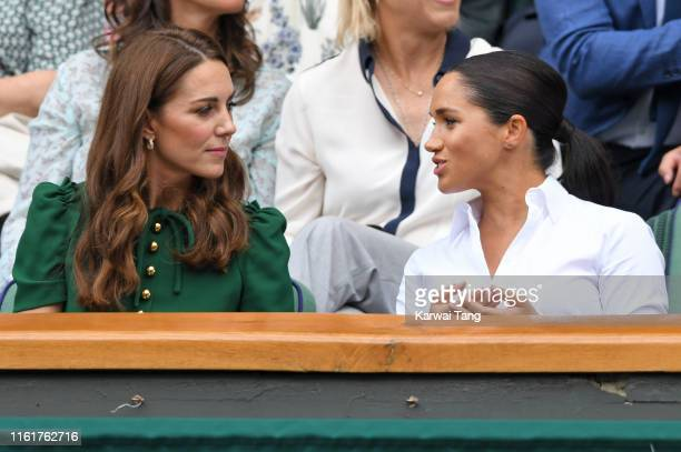 Catherine Duchess of Cambridge and Meghan Duchess of Sussex in the Royal Box on Centre Court during day twelve of the Wimbledon Tennis Championships...