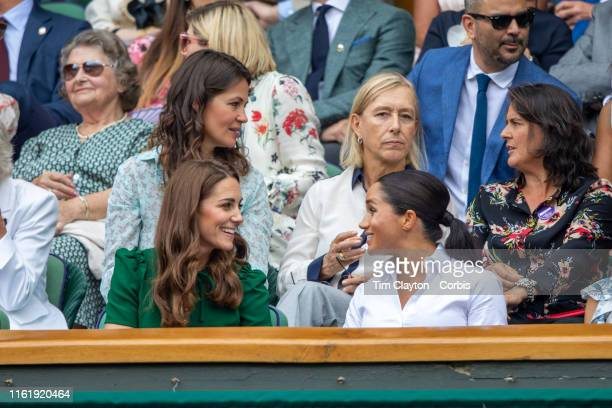 Catherine Duchess of Cambridge and Meghan Duchess of Sussex in the Royal Box on Centre Court during the Serena Williams of the United States match...