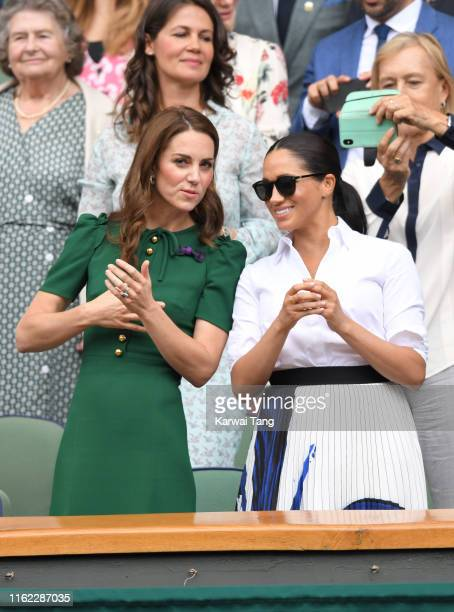 Catherine, Duchess of Cambridge and Meghan, Duchess of Sussex in the Royal Box on Centre Court during day twelve of the Wimbledon Tennis...