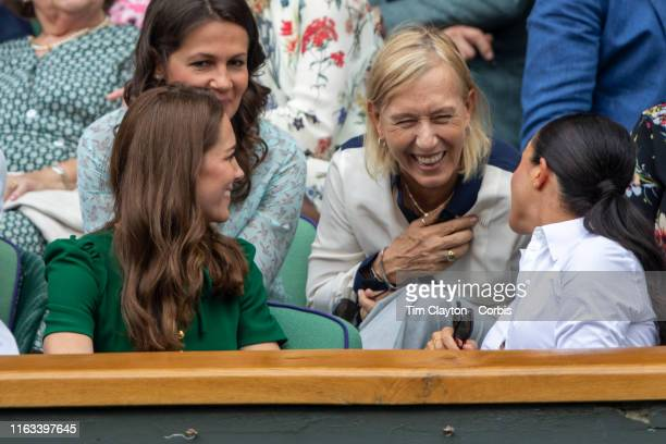 Catherine Duchess of Cambridge and Meghan Duchess of Sussex in the Royal Box on Centre Court talking with Martina Navratilova and her spouse Julia...