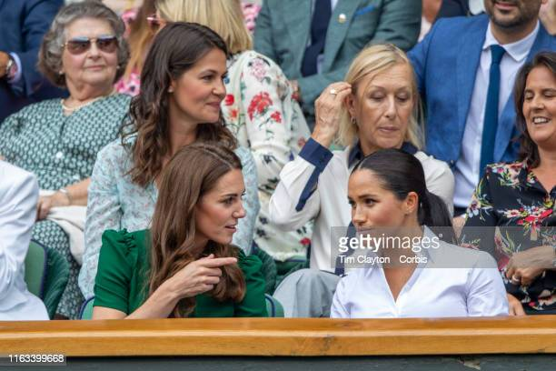 Catherine Duchess of Cambridge and Meghan Duchess of Sussex in the Royal Box on Centre Court along with Martina Navratilova and her spouse Julia...