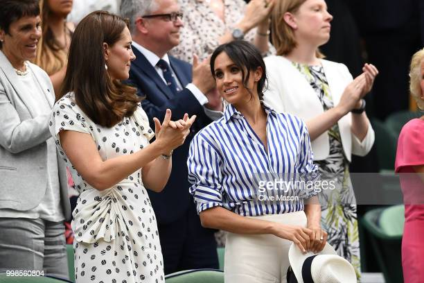 Catherine Duchess of Cambridge and Meghan Duchess of Sussex react after Novak Djokovic of Serbia beat Rafael Nadal of Spain in the Men's Singles...