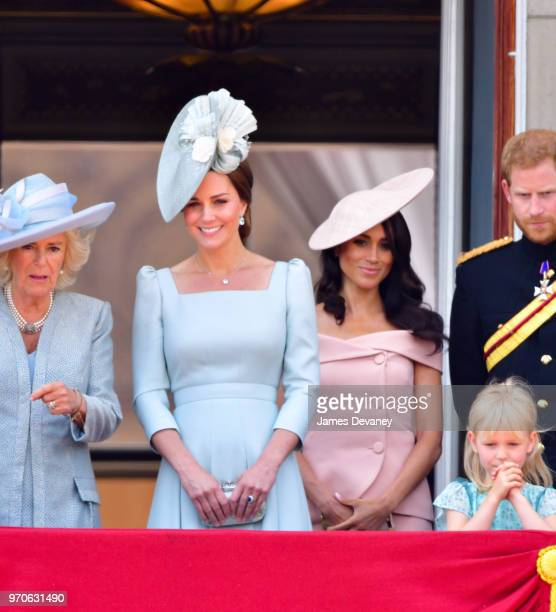 Catherine Duchess of Cambridge and Meghan Duchess of Sussex stand on the balcony of Buckingham Palace during the Trooping the Colour parade on June 9...