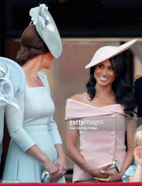 Catherine Duchess of Cambridge and Meghan Duchess of Sussex stand on the balcony of Buckingham Palace during Trooping The Colour 2018 on June 9 2018...