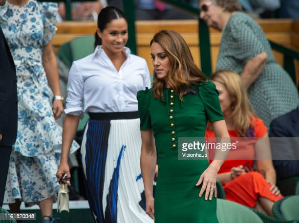Catherine Duchess of Cambridge and Meghan Duchess of Sussex take their seats in the Centre Court Royal Box before the Ladies Singles Final between...