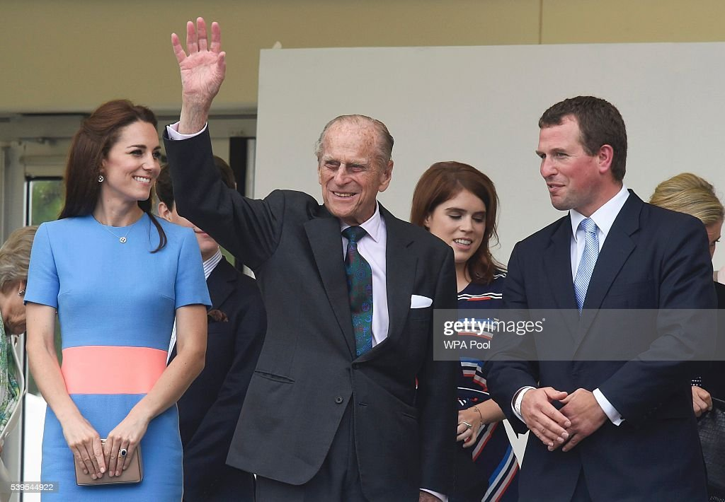 Catherine, Duchess of Cambridge (L) and Peter Phillips (R) look on as Prince Philip, Duke of Edinburgh (C) waves to guests attending 'The Patron's Lunch' celebrations for The Queen's 90th birthday on The Mall on June 12, 2016 in London, England. 10,000 guests have gathered on The Mall for a lunch to celebrate The Queen's Patronage of more than 600 charities and organisations. The lunch is part of a weekend of celebrations marking Queen Elizabeth II's 90th birthday and 63 year reign. The Duke of Edinburgh and other members of The Royal Family are also in attendance. During the lunch a carnival parade will travel down The Mall and around St James's Park.