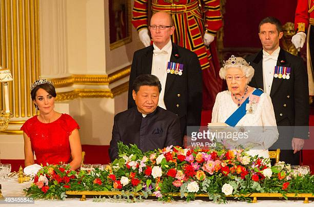 Catherine, Duchess of Cambridge and President of China Xi Jinping listen to Britain's Queen Elizabeth II speaks during a state banquet at Buckingham...
