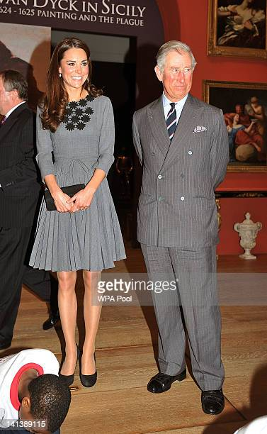 Catherine Duchess of Cambridge and Prince Charles Prince of Wales watch children produce artwork during a visit to the Dulwich Picture Gallery on...
