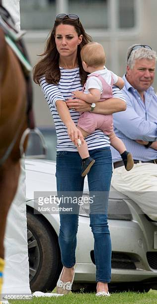 Catherine Duchess of Cambridge and Prince George attend the Jerudong Park Trophy at Cirencester Park Polo Club on June 15 2014 in Cirencester England