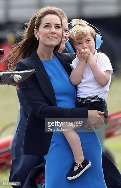 Catherine Duchess of Cambridge and Prince George during a visit to the Royal International Air Tattoo at RAF Fairford on July 8 2016 in Fairford...