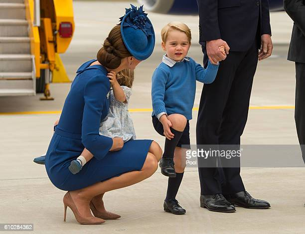 Catherine, Duchess of Cambridge and Prince George of Cambridge arrive at 443 Maritime Helicopter Squadron near Victoria international airport on...