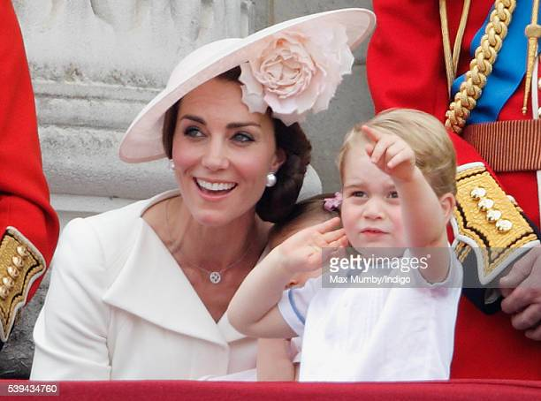 Catherine Duchess of Cambridge and Prince George of Cambridge watch the flypast from the balcony of Buckingham Palace during Trooping the Colour this...