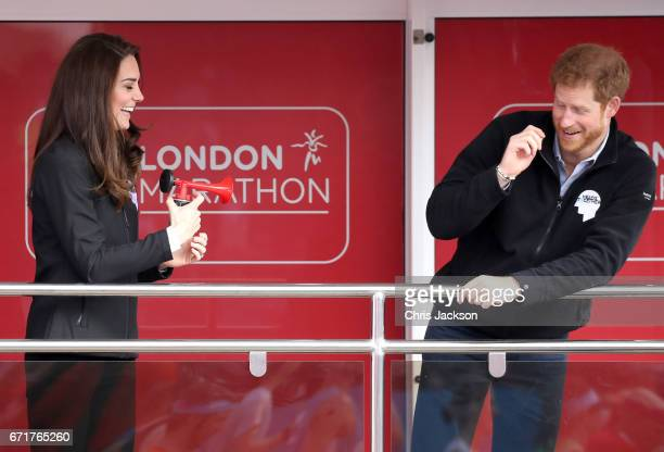 Catherine, Duchess of Cambridge and Prince Harry ahead of signaling the start of the 2017 Virgin Money London Marathon on April 23, 2017 in London,...