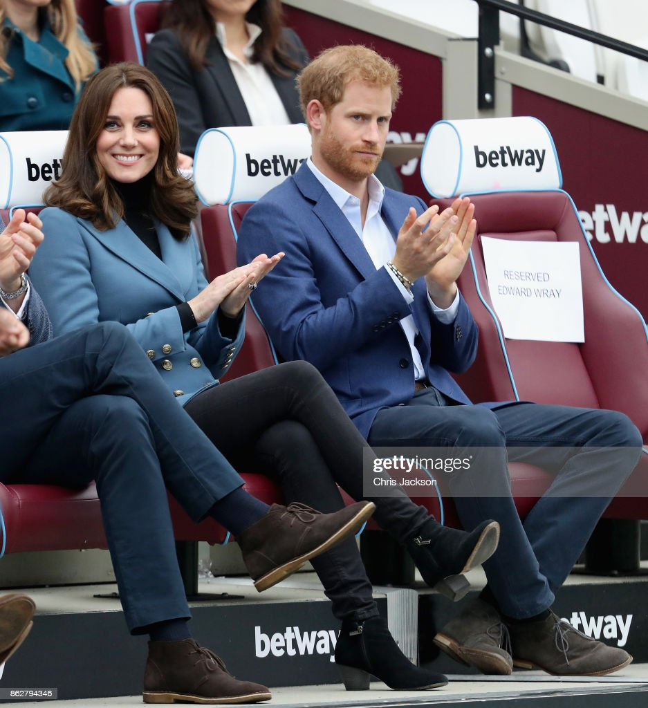 Catherine, Duchess of Cambridge and Prince Harry attend the Coach Core graduation ceremony for more than 150 Coach Core apprentices at The London Stadium on October 18, 2017 in London, England.