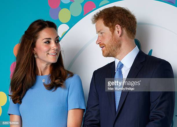 Catherine Duchess of Cambridge and Prince Harry attend 'The Patron's Lunch' celebrations to mark Queen Elizabeth II's 90th birthday on The Mall on...