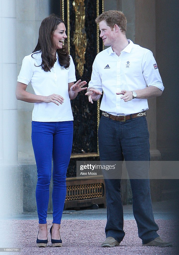 Catherine, Duchess Of Cambridge and Prince Harry Greet The Olympic Torch As It Arrives At Buckingham Palace on July 26, 2012 in London, England.