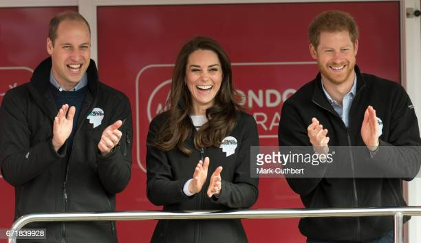 Catherine Duchess of Cambridge and Prince Harry with Prince William Duke of Cambridge during the 2017 Virgin Money London Marathon on April 23 2017...