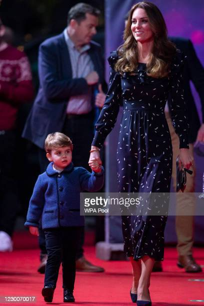 Catherine, Duchess of Cambridge and Prince Louis attend a special pantomime performance at London's Palladium Theatre, hosted by The National...