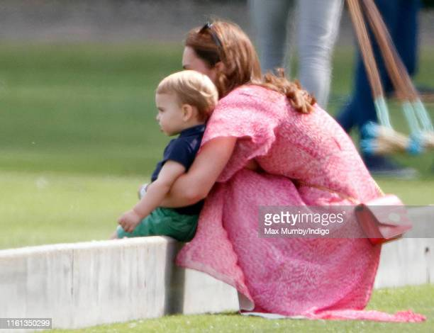 Catherine Duchess of Cambridge and Prince Louis of Cambridge attend the King Power Royal Charity Polo Match in which Prince William Duke of Cambridge...
