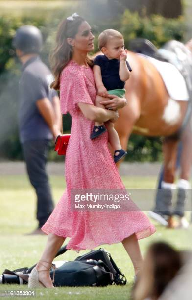 Catherine, Duchess of Cambridge and Prince Louis of Cambridge attend the King Power Royal Charity Polo Match, in which Prince William, Duke of...