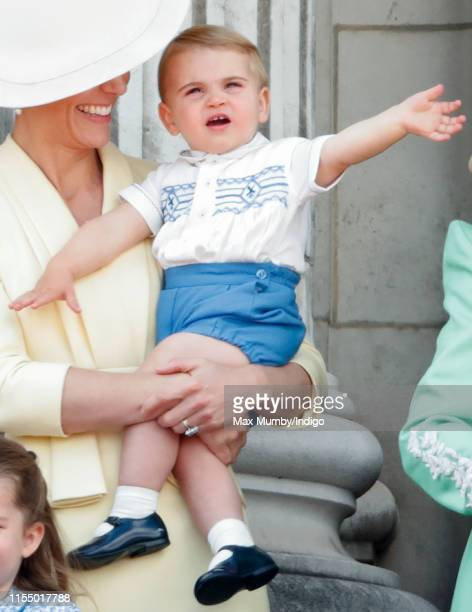 Catherine, Duchess of Cambridge and Prince Louis of Cambridge watch a flypast from the balcony of Buckingham Palace during Trooping The Colour, the...