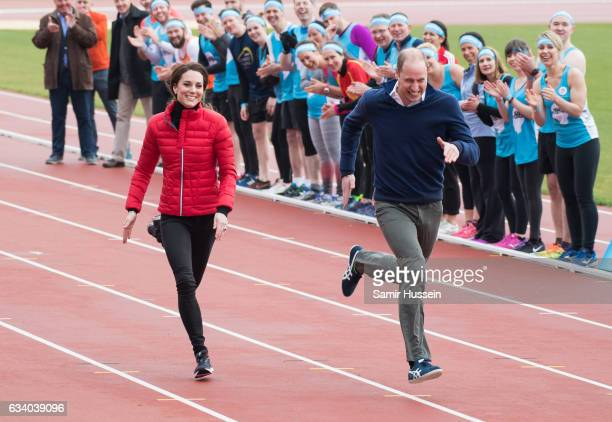 Catherine, Duchess of Cambridge and Prince Wiliam, Duke of Cambridge take part in a race during a training day for the Heads Together team for the...