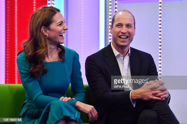 Catherine Duchess of Cambridge and Prince William Duke of Cambridge laugh as they visit BBC Broadcasting House on November 15 2018 in London England...