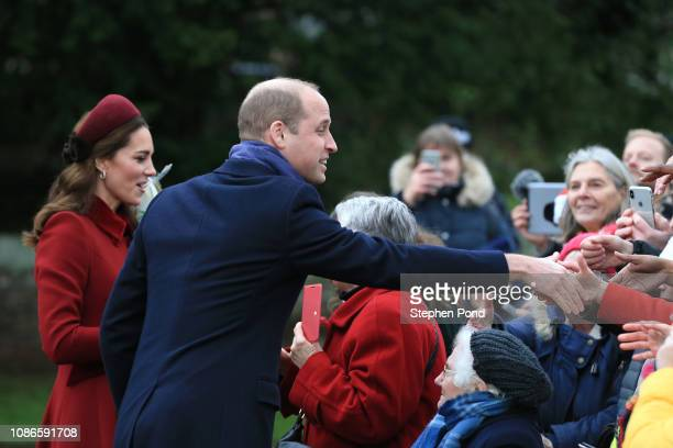 Catherine Duchess of Cambridge and Prince William Duke of Cambridge greet well wishers as she attend Christmas Day Church service at Church of St...