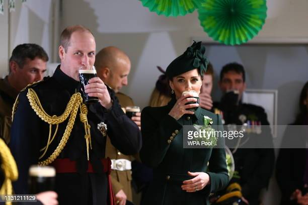 Catherine Duchess of Cambridge and Prince William Duke of Cambridge enjoy a pint of Guinness after attending the St Patrick's Day parade at Cavalry...