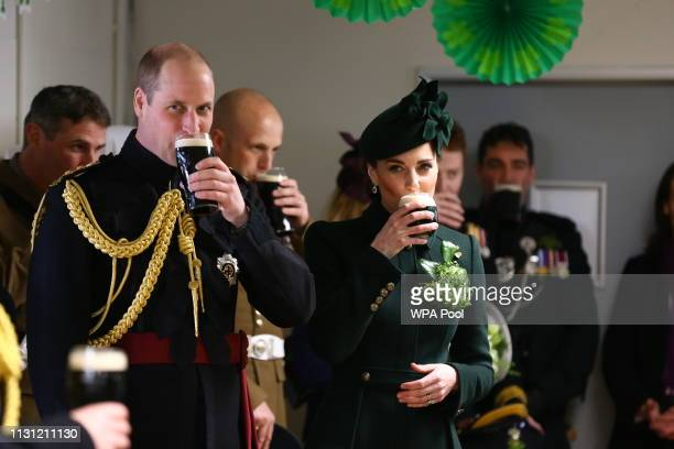 Catherine, Duchess of Cambridge and Prince William, Duke of Cambridge enjoy a pint of Guinness after attending the St Patrick's Day parade at Cavalry...