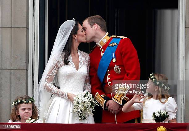 Catherine, Duchess of Cambridge and Prince William, Duke of Cambridge kiss on the balcony at Buckingham Palace on April 29, 2011 in London, England....
