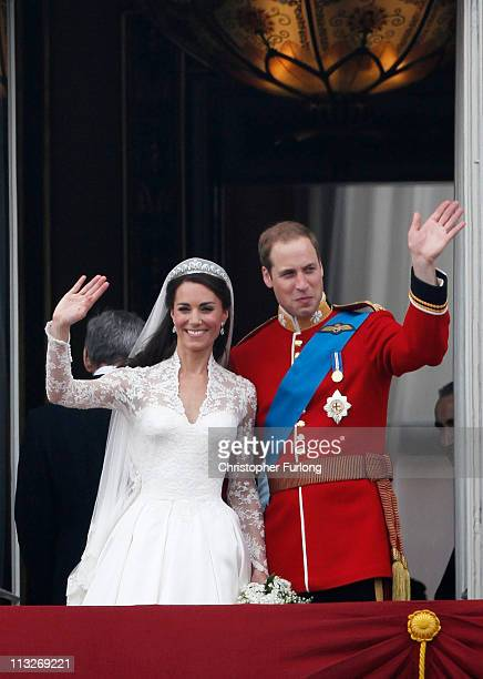 Catherine, Duchess of Cambridge and Prince William, Duke of Cambridge wave to wellwishers on the balcony at Buckingham Palace on April 29, 2011 in...